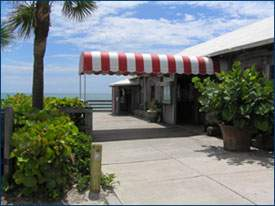 Exterior of Ocean Grill with red and white awning